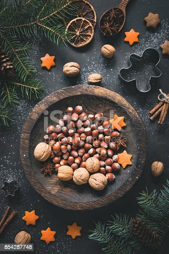 istock Christmas Winter decorations, nuts, spices and stars still life 854287748