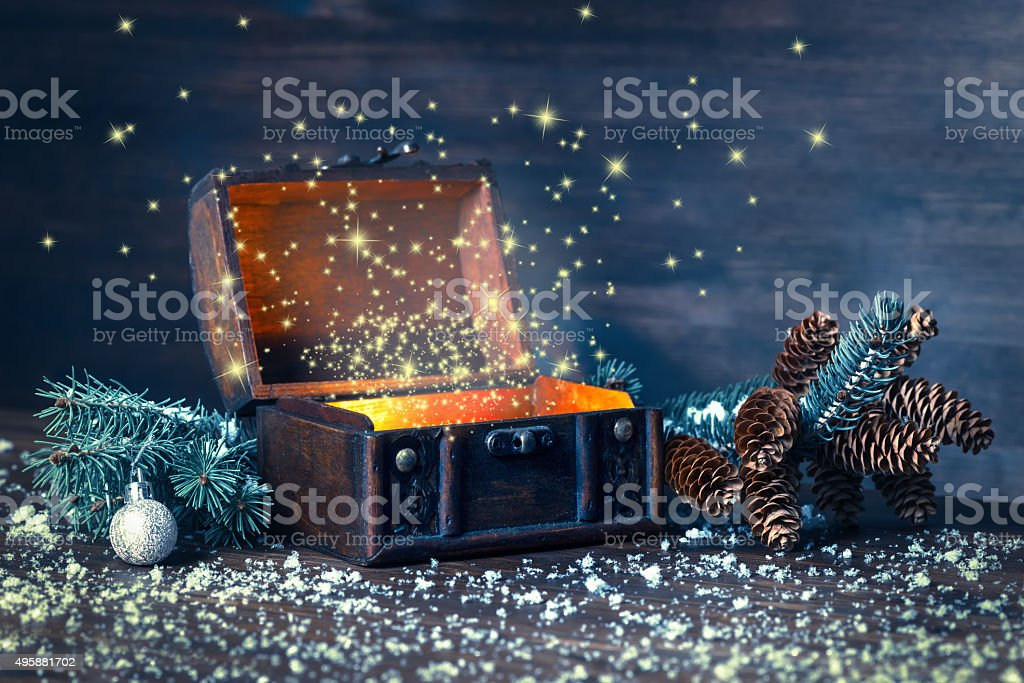 Christmas winter fairy with miracle in opened chest. Background stock photo