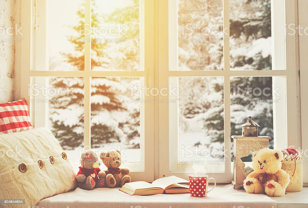 Christmas winter window with a book, a cup of tea stock photo