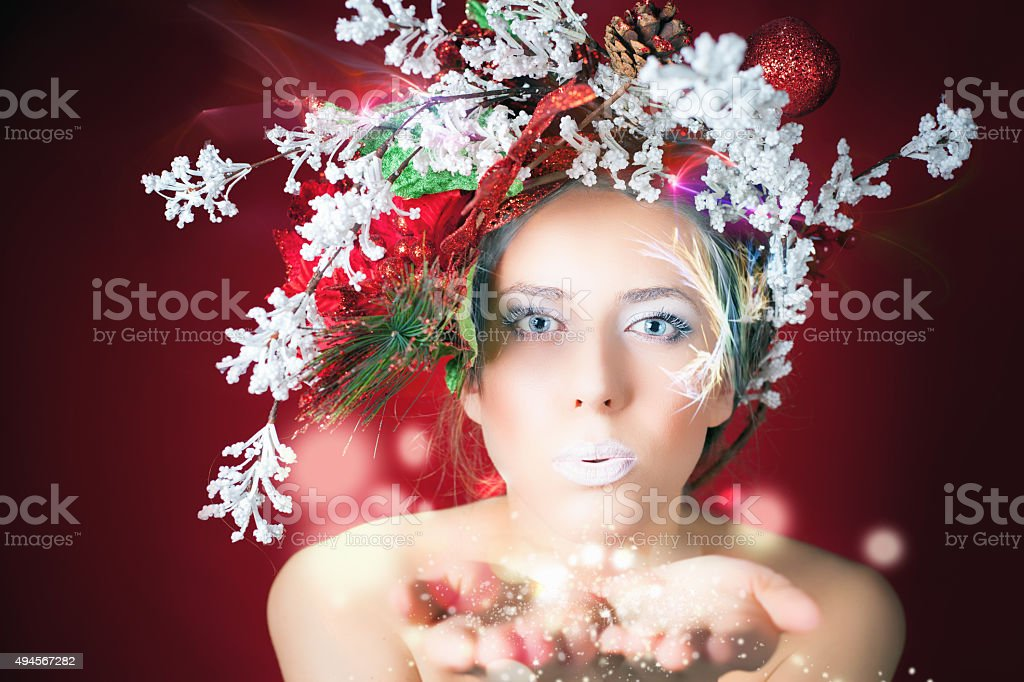 Christmas winter woman with tree hairstyle and makeup, magical fairy stock photo
