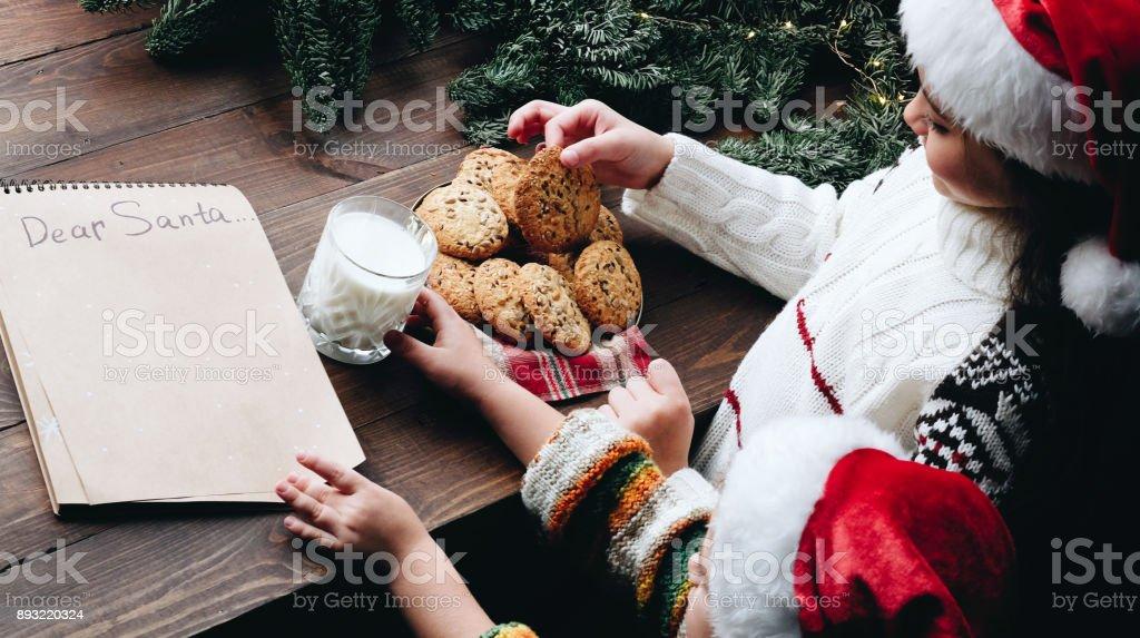 Christmas wish list letter, Children make surprise present for Santa...