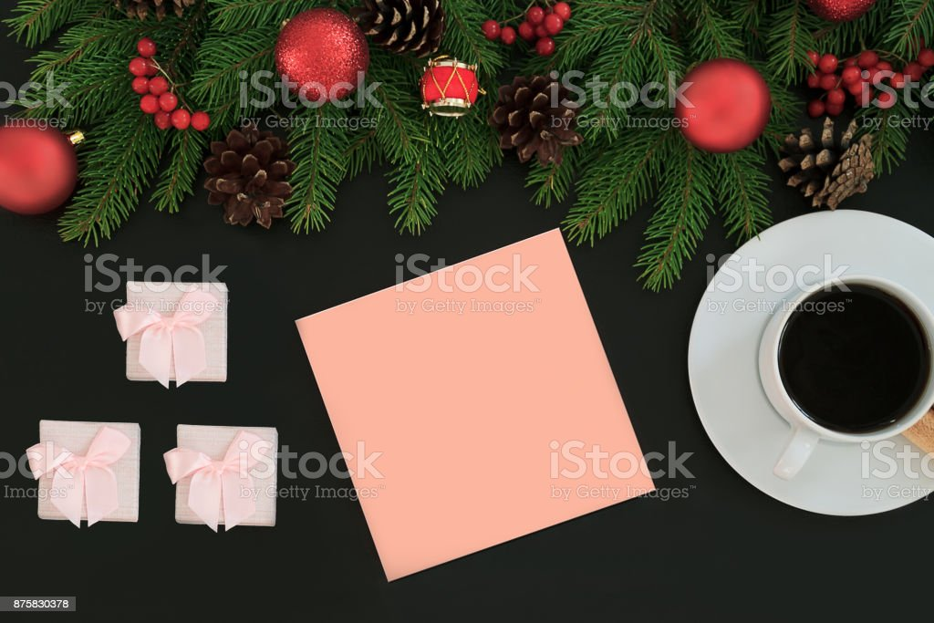 Christmas wish list writing. Woman creating present list for winter holidays. Top view, preparing for xmas and new year concept. Black backtop stock photo