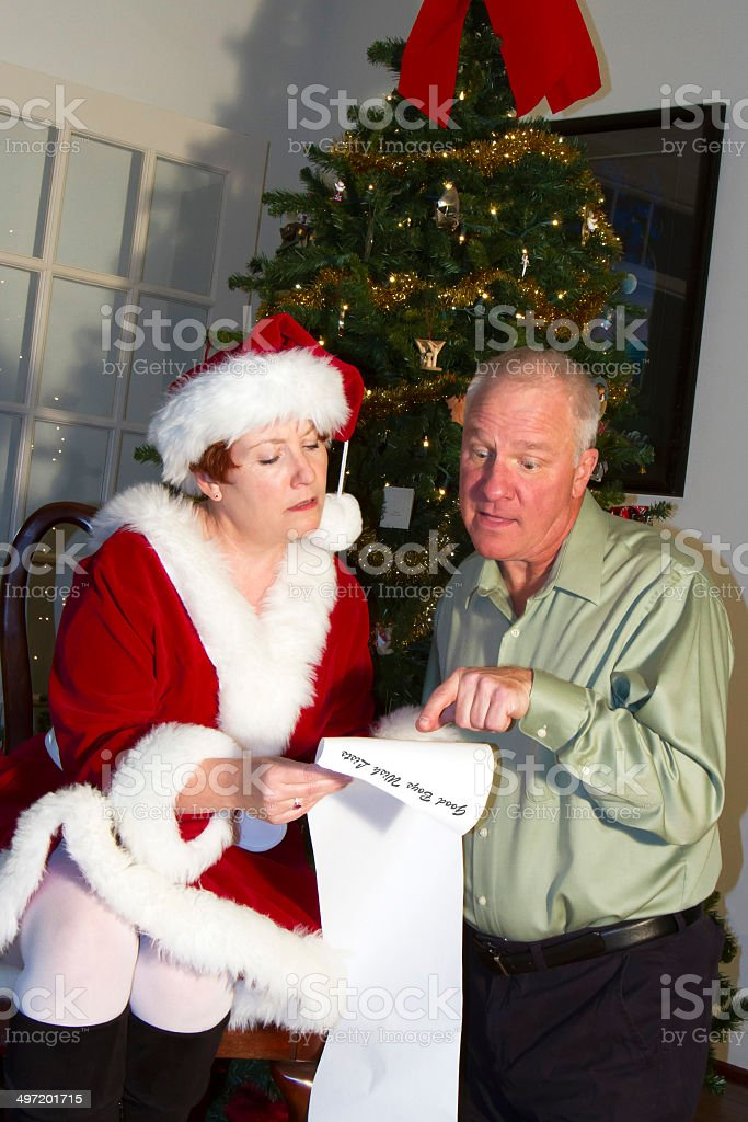 Man anxiously looking for his Christmas gift on Santa\'s List being...