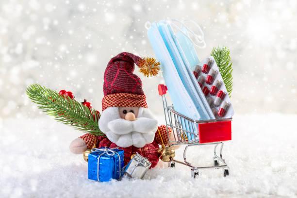 Christmas with Santa Claus coronavirus. Christmas composition. stock photo