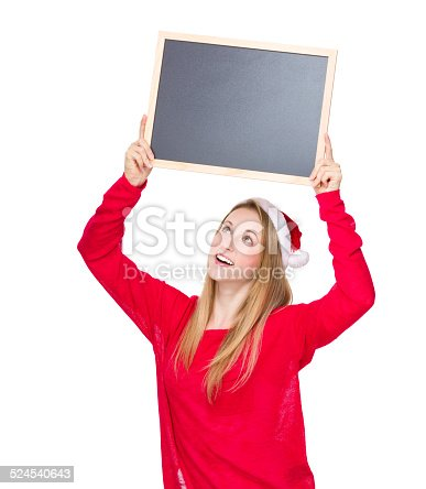 istock Christmas woman look at the chalkboard 524540643
