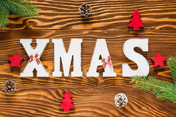 Christmas Wood Decoration in Brown and Red Color stock photo