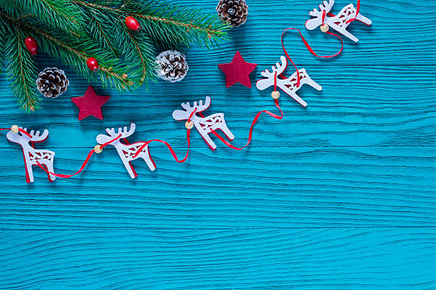 Christmas Wood Decoration in Turquoise and Red Color stock photo