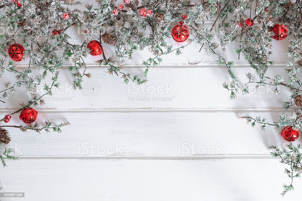 Christmas wooden background. Christmas jingle bells and pine branch foto de stock royalty-free