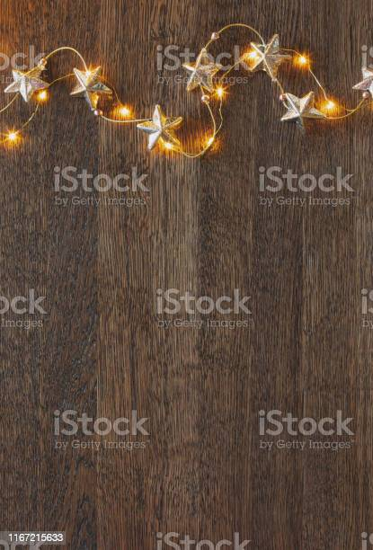 Christmas wooden background with festive decorative garland picture id1167215633?b=1&k=6&m=1167215633&s=612x612&h=nn53woszby6u48lnuk7 o axahvvtsjm0bqsavji4u4=