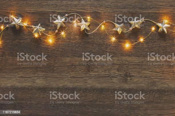 Christmas wooden background with festive decorative garland picture id1167215634?b=1&k=6&m=1167215634&s=612x612&h=yu2eaevlpfxj9dlwitxqkfrz5jnyyaw2gyfq7deamrq=