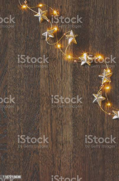 Christmas wooden background with festive decorative garland picture id1167215636?b=1&k=6&m=1167215636&s=612x612&h=3vgweb3sv74n10pynx0 qolguy7i897xfff54pqbwym=