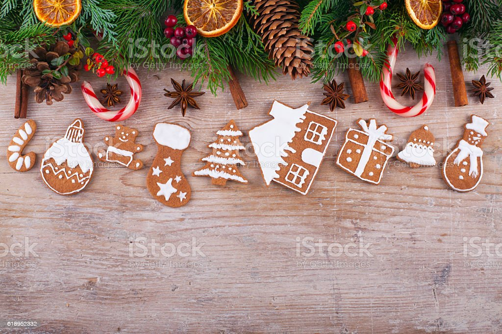 Christmas wooden background with fir tree, spices, gingerbread cookies stock photo