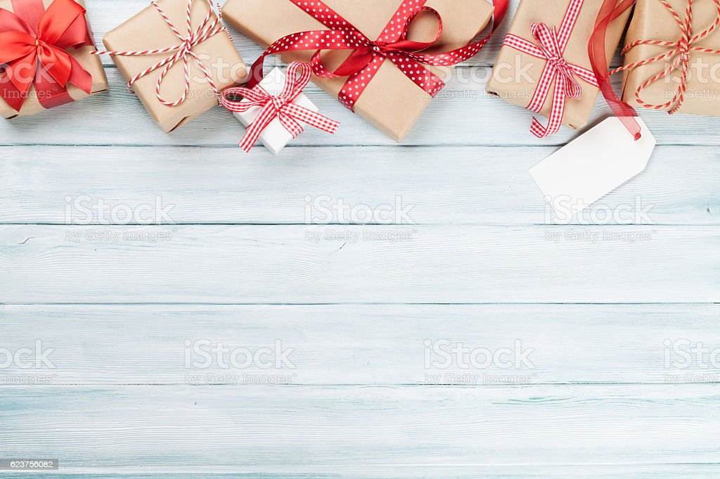 Christmas Wood Background.Christmas Wooden Background With Gift Boxes Stock Photo