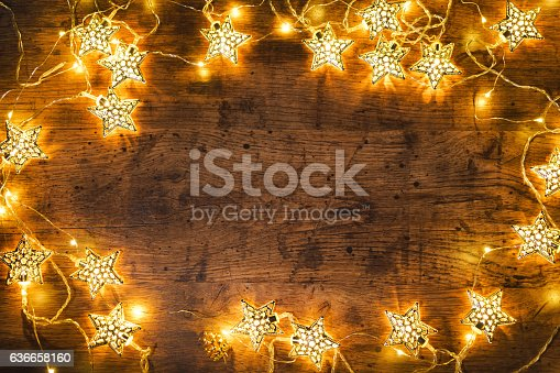 istock Christmas wooden background with lights. 636658160