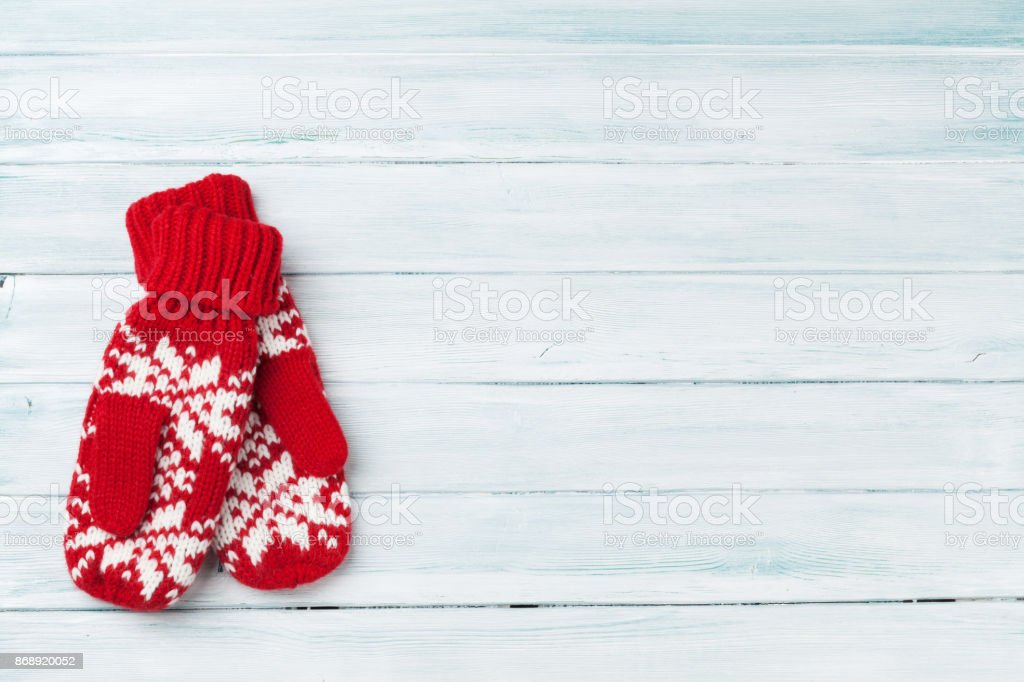 Christmas wooden background with mittens stock photo