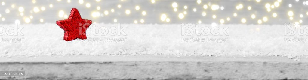 Christmas wooden background with red star and snow stock photo