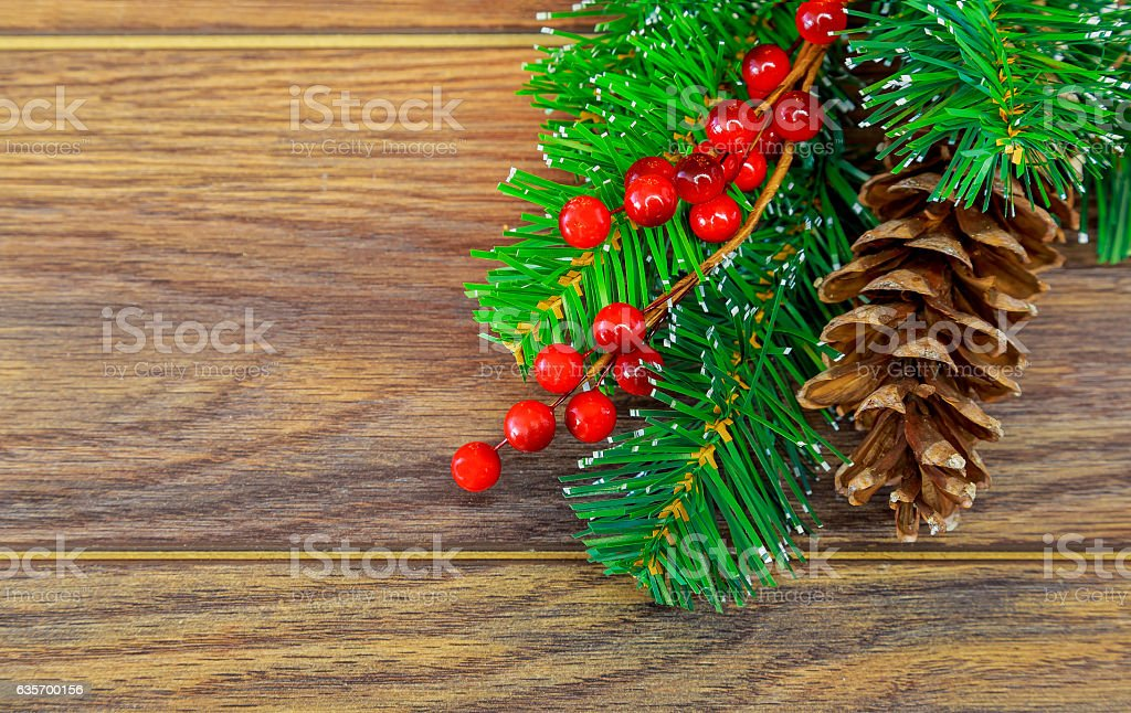 Christmas wooden background with snow fir tree holly berry royalty-free stock photo