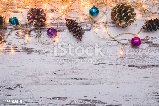istock Christmas wooden background with snow fir tree. Top view with copy space for your text 1176498519