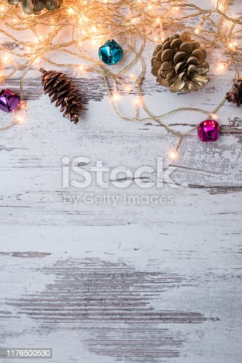 istock Christmas wooden background with snow fir tree. Top view with copy space for your text 1176500530