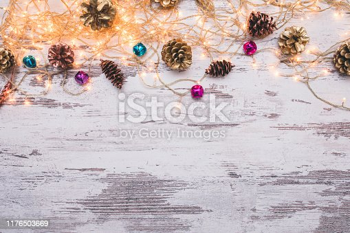 istock Christmas wooden background with snow fir tree. Top view with copy space for your text 1176503669