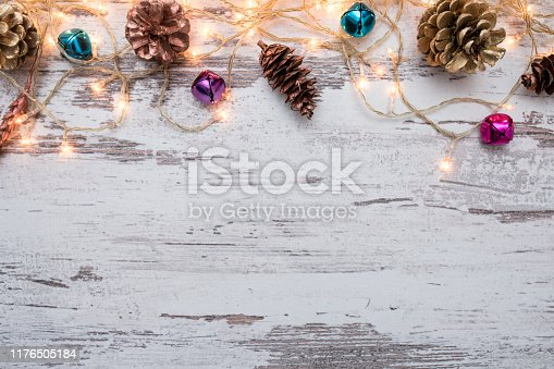 istock Christmas wooden background with snow fir tree. Top view with copy space for your text 1176505184