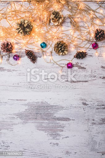 istock Christmas wooden background with snow fir tree. Top view with copy space for your text 1176505522