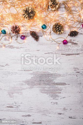 istock Christmas wooden background with snow fir tree. Top view with copy space for your text 859002854