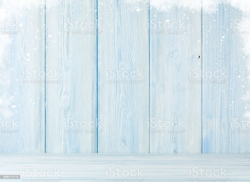 Christmas wooden background with snow stock photo