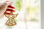 istock Christmas wooden decorations, angel in hand on light background. Side view, copy space. Layout made of winter. Holiday season concept. 1170651661