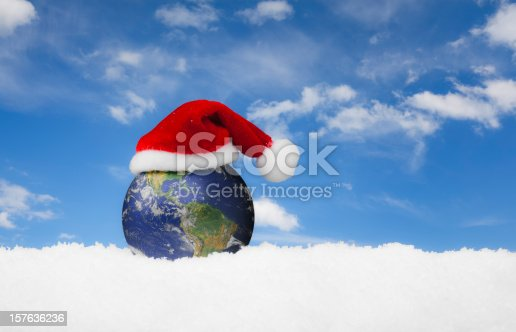 istock Christmas World - Santa Hat on the Earth 157636236