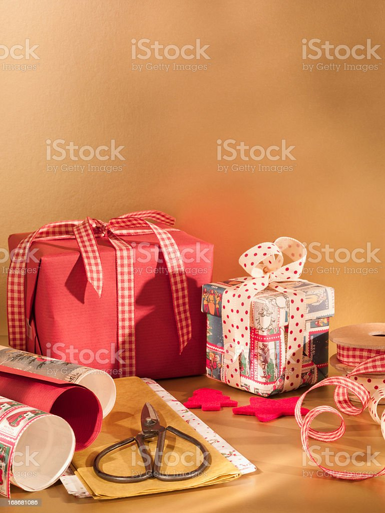 Christmas wrapping paper, ribbon and scissors royalty-free stock photo