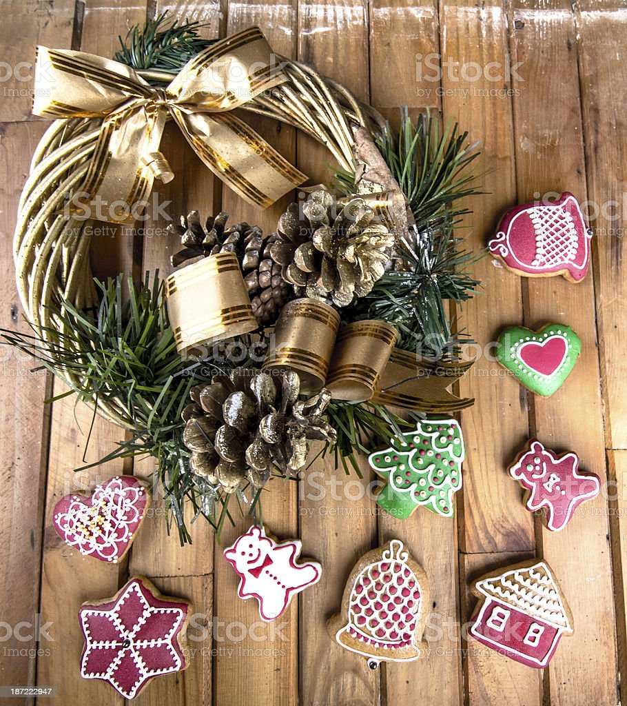 Christmas wreath and gingerbread on the wood royalty-free stock photo