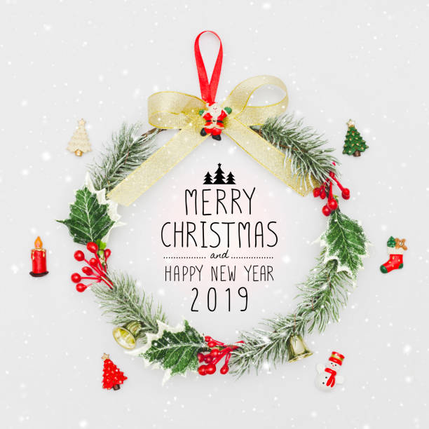 christmas wreath and happy new year 2019 decorative ornament on white background with snow falling.gifts and congratulations holidays concept. - tree logo stock photos and pictures