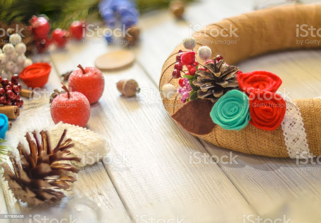 Christmas wreath and ribbon bow on a wooden board background. Christmas decoration. stock photo