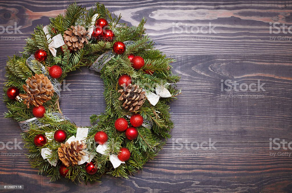 Christmas wreath and ribbon bow on wooden background bildbanksfoto