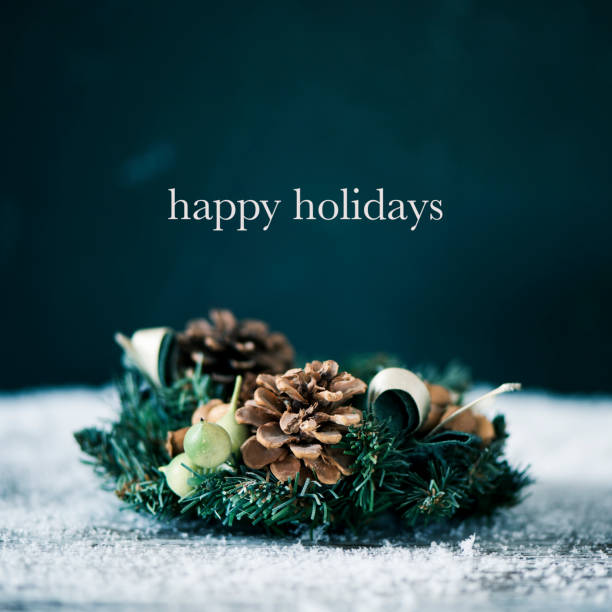 christmas wreath and text happy holidays - happy holidays stock pictures, royalty-free photos & images