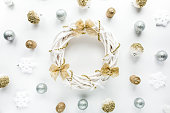istock christmas wreath frame made of colored bright golden christmas balls on white background. flat lay, top view 1272681370