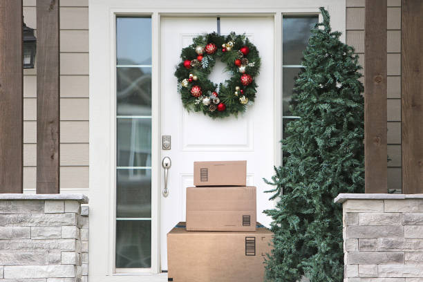 Christmas Wreath Front Door Packages front door with christmas wreath and packages package stock pictures, royalty-free photos & images