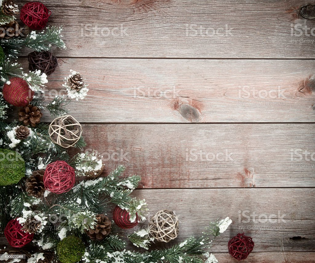 Christmas wreath garland border on a wood background stock