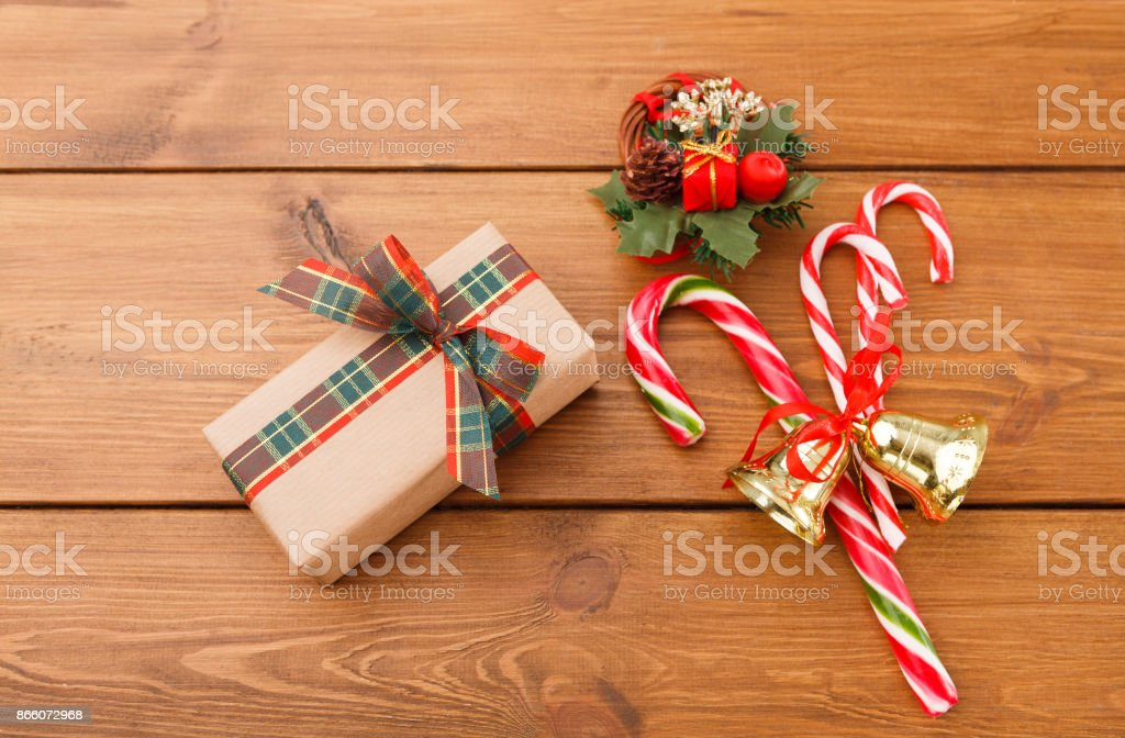 Christmas Wreath Gift Box In Craft Paper And Xmas Candy On Rustic Wood Background Stock Photo Download Image Now Istock