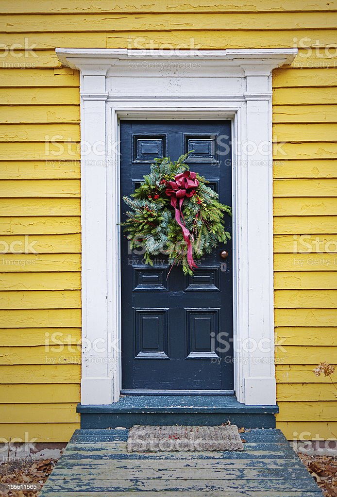 Christmas Wreath, Green Door, Yellow House royalty-free stock photo