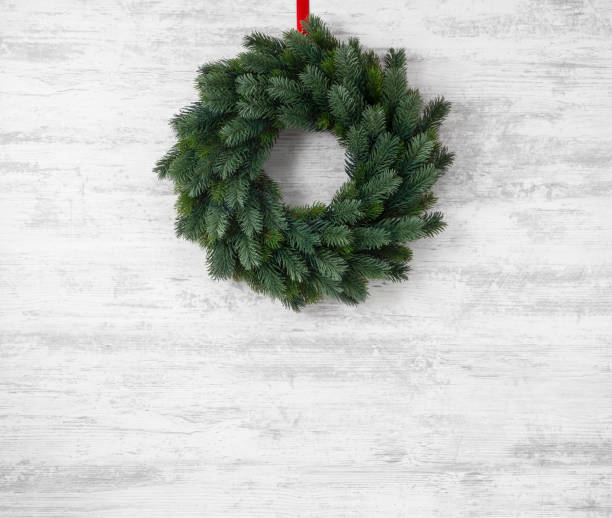 Christmas wreath hanging on wooden background picture id886654838?b=1&k=6&m=886654838&s=612x612&w=0&h=8tpqziv7bd2vxt0x2j3ntvfypmswap4dsylsl2bqwtk=