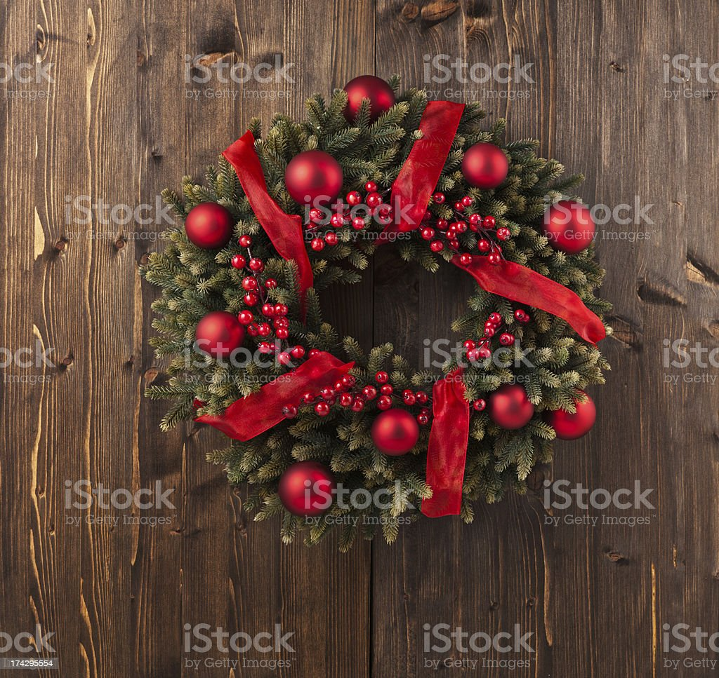 Christmas wreath made from fir branches and red baubles royalty-free stock photo