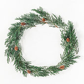 istock Christmas wreath made of cypress branches. Flat lay, top view 865084898