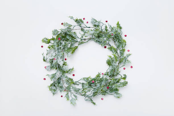 Christmas wreath made of holly plant with berries, flat lay stock photo