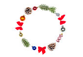 istock Christmas wreath of Christmas toys, cones and fir branches isolated on white background. Flat lay, top view, copy space 1054919796