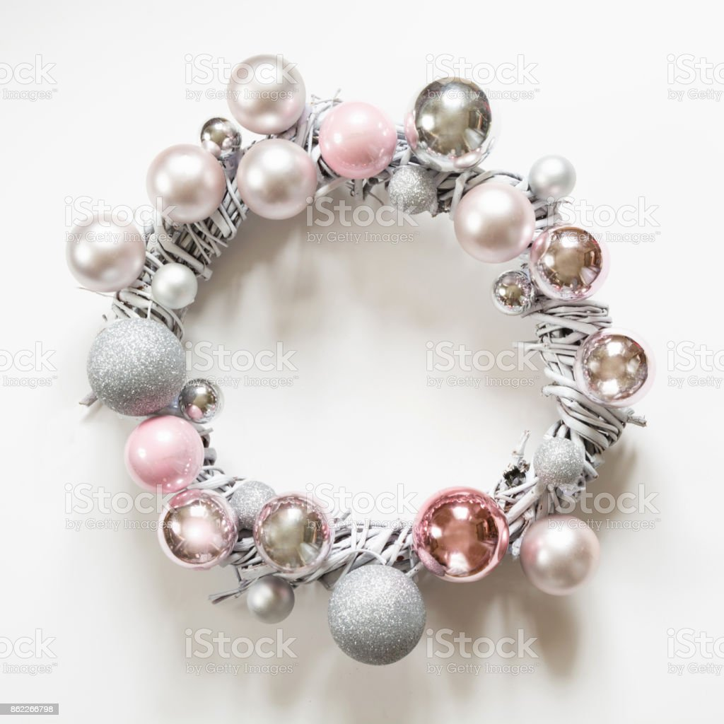 Christmas wreath of decor, silver and pink balls, painted vine on white. stock photo