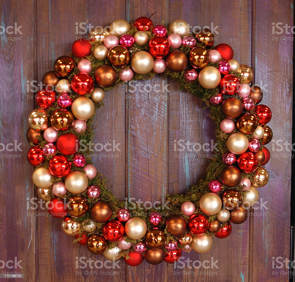 A Christmas wreath of red and gold baubles royalty-free stock photo