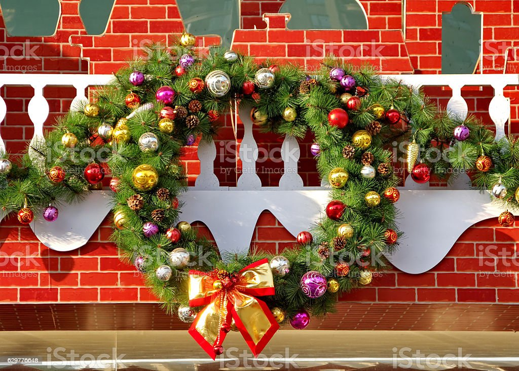 Christmas wreath oh the wall stock photo