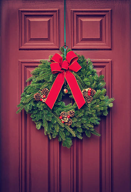 Christmas wreath on a red door stock photo